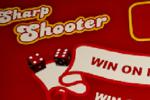 Sharp Shooter – Eliminera de tre måltärningarna som husets croupier slår